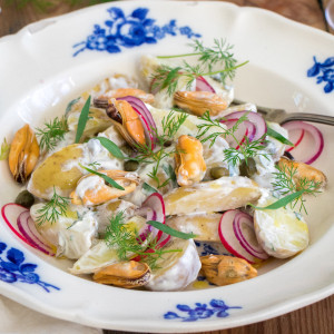 Potato salad with mussels, crème fraîche, tarragon and gherkin