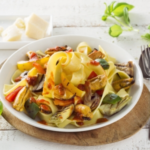 Pappardelle pasta with grilled Mediterranean vegetables, stir-fried mussels and Romesco sauce