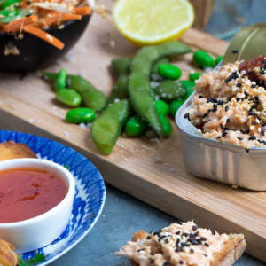 Asian smoked salmon salad with soy sauce, mayonnaise and sesame seeds