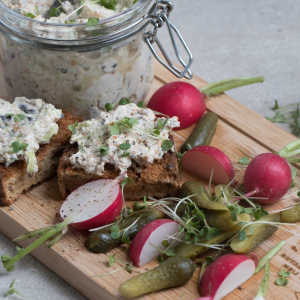 Smoked mussels and cream cheese, black olives and spring onion spread on toast