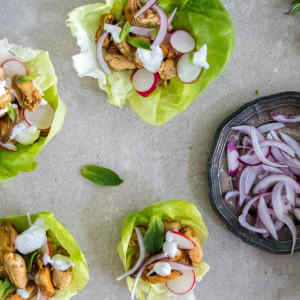 Lettuce wraps filed with mussels fried in ras el hanout